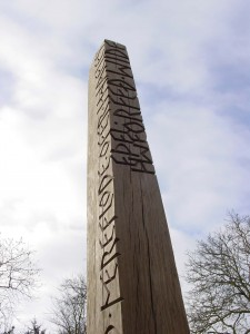 carved wooden obelisk by Gary Breeze